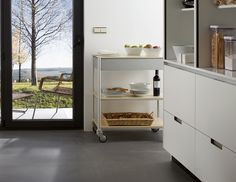 SANTOS kitchen. Multi-function trolley. Multi-function trolley made in aluminium and birch wood, equipped with wheels, with incorporated brakes. It can be moved easily and swiftly on any surface.