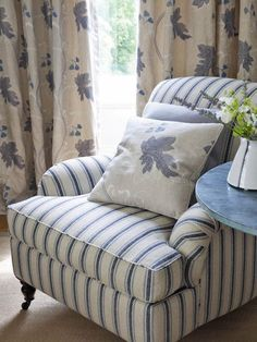 Colefax And Fowler's Gresham Stripe (chair), Kashmir Leaf (pillow and drapes), Suffolk (pillow) #colefaxandfowler #textiles #fabric