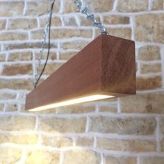 Love the minimalist style of this lighting for beams, it really doesn't get more minimal than just a block of wood! Theyhave purposely chosen a beautiful