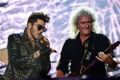 Brian May (R) of the British rock band Queen and the US singer Adam Lambert perform during the Rock in Rio music festival on its opening day in Rio de Janeiro on September 19, 2015. The festival is on its 30th anniversary and will run for two weekends.     (Photo credit: CHRISTOPHE SIMON/AFP/Getty Images)