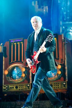 Alex Lifeson, Rush.  He needs the Varvatos red leather vest.  And Geddy the top hat and Monocle