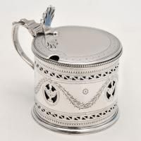 George III Sterling Silver Mustard Pot Hallmarked in London, 1780 by Hester Bateman, this delightful,, George III, Antique, Sterling Silver Mustard Pot, is drum shaped, and features pierced and engraved decoration, bead borders, and a blue glass liner.