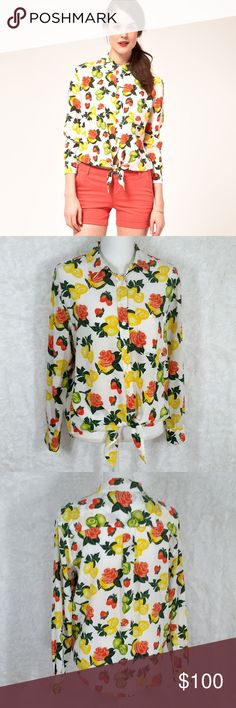 """Equipment Silk Daddy Tie Shirt In Fruit Print 337 Hi Guys! i'm Selling this Equipment Femme Silk Daddy Fruit Shirt! It's a size Small in Great Condition! it's got a lovely fruit praint with a tie at the bottom and a cute little pocket on the front. last seen for $350. Measurements: Pit to pit is 21"""". Waist 21.5"""". Length 23.5"""". Equipment Tops"""