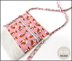 {stinkin' cute} Zip Zap Mini Pouch with Side Loop Straps | Sew4Home