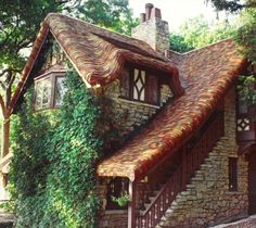 stone tudor revival cottage with thatch style roof of cedar shingles house-dreams Storybook Homes, Storybook Cottage, Tudor Cottage, Tudor House, Cozy Cottage, Cottage Homes, Cottage Style, Stone Cottages, Cabins And Cottages