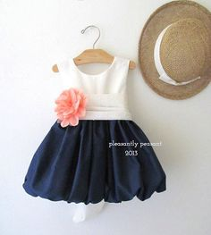 Navy, coral and white flower girl dress - see more info at http://themerrybride.org/2014/11/24/coral-and-navy-wedding-2/