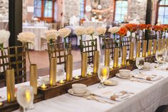 gold centerpieces - photo by Izzy Hudgins http://ruffledblog.com/glitzy-bohemian-ny-wedding/