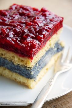 White Cake with Poppyseed Filling and Raspberry Topping