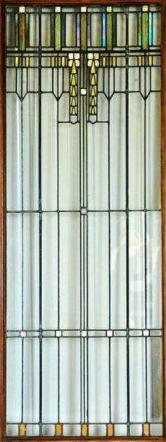 "Leaded Glass Light Screen. Attributed to Frank Lloyd Wright. Iridescent, Opalescent, Clear and Colored Glass. 80"" high."