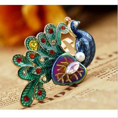 Unique Adjustable Multicolor Peacock Animal Ring    History: 164 sold  $4.99