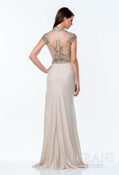 Stunning+column+gown+with+romanesque+embellishments+over+the+nude+illusion+top,+cap+sleeves,+and+mandarin+collar;+the+dress+is+finished+with+a+sleek+chiffon+skirt