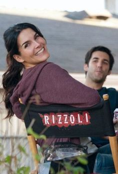 Angie Harmon and Jordan Bridges. A Dw with a deep softened Winter purple