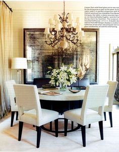 I love a round table in a dining room.