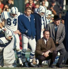 Two Hall of Famer's: QB Johnny Unitas, in jacket, stands beside his coach, Don Shula (kneeling), in this photo. Football Coaches, American Football Players, Sport Football, School Football, Football Stuff, Football Fans, Baltimore Colts, Indianapolis Colts, Baltimore Maryland