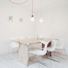 White dining chair * rustic wooden table * single pendant light bulbs