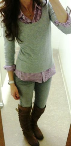 Button up shirt under sweaters.