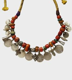 Morocco | Amber, coral, silver coins, amazonite and silver necklace | Late 19th century | The women of southern Morocco have a preference for bold, colorful and flamboyant designs and collect quantities of valuable jewellery of silver, coral and amber. Moroccan silver coins in the necklace date from 1878(1299 in the Islamic calendar).