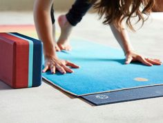 There's a right way and a wrong way to do it. Here's how the pros say to keep your beloved mat spic and span. (Or just less gross.)