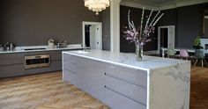 desire to inspire - desiretoinspire.net - Artichoke- gray cupboards, white counters, herringbone wood floors