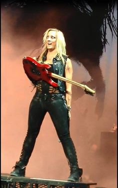 Nita Strauss on stage with Alice Cooper.