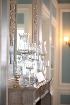 beautiful glasses on the mantlepiece as decoration