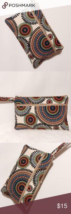"⭐️ Ethnic Print Cotton Clutch Sassy! Printed clutch, brown, black, orange, blue and green on a cream background. Zipper closure with external zipper pocket. 6"" strap 7"" H X 11"" W Bags Clutches & Wristlets"