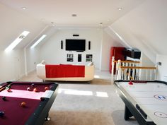 This loft conversion is a great space for all the family to come and enjoy and relax together with the pool table, air hockey, tv and games consoles a real family room. Modern with the white walls and neutral flooring.  #loftconversion #atticspace #loftspace #gamesroom #familyroom#mancave #home #inspiration #extension    Image source: www.insolumprojects.co.uk
