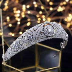 The The ReMARKable Royal Tiara is just like the Meghan Markle tiara she borrowed from the crown jewels in her royal wedding. This silver tiara replica is decorated in silver and sparkling cubic zirconia stones that give it quality without being expensive. Royal Crowns, Royal Tiaras, Tiaras And Crowns, Royal Crown Jewels, British Crown Jewels, Gold Crown, Wedding Hair Accessories, Wedding Jewelry, Women Accessories