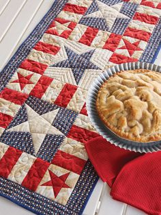 """- MY PATRIOTIC TABLE RUNNER PATTERN by Jean Nolte: Finish this spunky table runner in an afternoon. Our Sew Easy lesson helps you create one-of-a-kind stars.  Finished Size: 20"""" x 44"""" Finished Blocks: 3 (8"""") Star blocks and 8 (4"""") Star Blocks"""