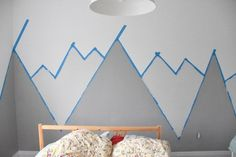 How To Paint A DIY Nursery Mountain Mural (No Art Skills Required) - Looking for an amazing kids room or nursery decor idea? DIY this painted mountain range mural – e - Mountain Mural, Mountain Nursery, Mountain Decor, Mountain Landscape, Diy Nursery Decor, Nursery Room, Nursery Ideas, Room Decor, Budget Nursery