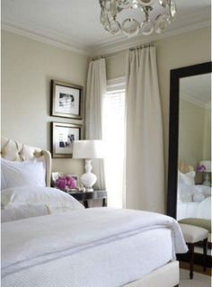 IN LOVE...nothing says classic, clean, and simple like this bedroom. from the cream walls, big white comfy bed, to bold black mirror....i want it all.