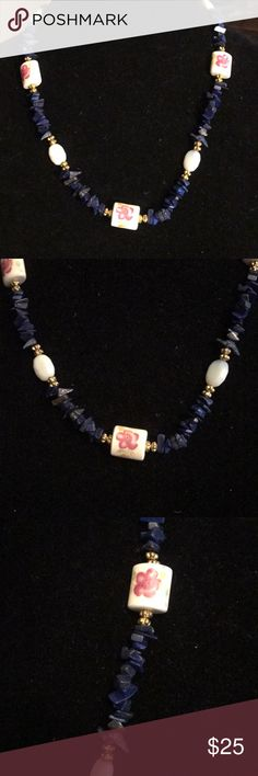 """🛍🎉lapis and porcelain necklace handcrafted Pretty necklace made with lapis lazuli chips, porcelain flower beads and opalite with a toggle clasp. Necklace measures 22 3/4"""". Handcrafted in my home studio and one of a kind. I believe each piece of jewelry be as unique as the woman wearing it. All gemstones are authentic and designer grade. Free earrings with any jewelry purchase. Will arrive in an organza pouch. Please check out my closet for more one of a kind jewelry. Bundle two or more…"""