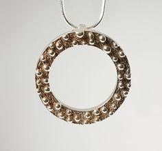 Round pendant , 925 silver ,modern pendant in a fresh design.