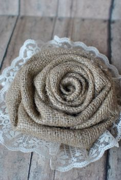 Burlap and lace flower accent- perfect addition to wedding decor and flower girl baskets. $12.00, via Etsy.