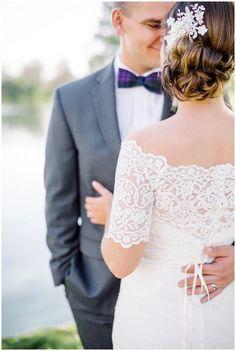 Elegant outdoor bride and groom portraits | purple bowtie