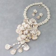 @Overstock - Make a statement with this jewelry set that showcases stunning floral dangle design made of mother of pearl shell accentuated with natural white freshwater pearls. This jewelry set was handmade in Thailand.  http://www.overstock.com/Worldstock-Fair-Trade/White-Shell-Pearl-Grand-Floral-Bouquet-Jewelry-Set-3-7-mm-Thailand/6087586/product.html?CID=214117 $91.99