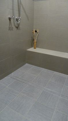 Simple And Stunning Shower Design Featuring LUXE Tile Insert Linear Drain.