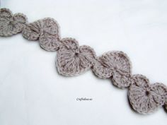String of hearts, found on : http://www.craftideas.us/valentine-craft-ideas-crochet-string-of-hearts-scarf.html