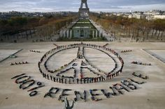 Hundreds of environmentalists arrange their bodies to form a message of hope and peace in front of the Eiffel Tower in Paris, France, December 6, 2015, as the World Climate Change Conference 2015 (COP21) continues at Le Bourget near the French capital. REUTERS/Benoit Tessier