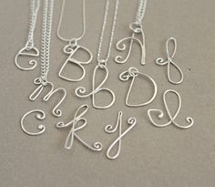 silver initial necklace. alphabet letters. personalized in sterling silver. bridesmaid or friend gift.  mothers necklace.. $27.00, via Etsy.