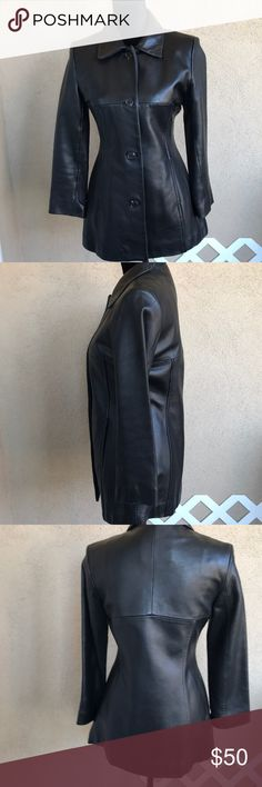 Andrew Marc Marc New York black leather coat sz PS Gorgeous soft black leather jacket Andrew Marc size PS button front has been worn a few times. A few little marks nothing major. This jacket fits perfect fully lined hidden front pockets. Tag was marked to prevent retail return. Andrew Marc Marc New York Jackets & Coats