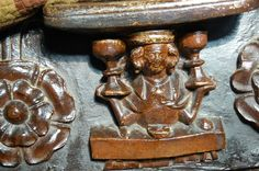 January. A man with 2 cups, one for the old year, and one for the new, Misericord, Great Malvern Priory (by Julian P Guffogg, geograph.co.uk 3087096 9862a8e8) - Category:Misericords in England - Wikimedia Commons