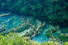 Semuc Champey in Guatemala is a popular travel destination with a beautiful series of stepped, turquoise pools that travelers swim in. ~ http://www.baconismagic.ca