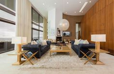 - see how sophisticated the navy-royal-dark blue sofas makes the space - yet the light wood is a softer shade of accent walls - which would matchen kitchen and butler pantry cabinets... then the cream / soft blue pillows tie it together... use light wood for other accent pieces - would need to paint...