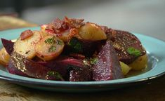 """Nigel Slater serves up bacon potatoes and beets on Nigel Slater's Dish of the Day. Nigel says: """"A filling, one-pan dish of bacon and potatoes, fried with beetroot with a horseradish kick."""" The ingredients are: 2 beetroot, 8 new potatoes, 4 rashers smoked streaky bacon, groundnut oil, for frying, 2 tbsp grated fresh horseradish and handful mint.  Related PostsHelen's Malaysian Coconut pandan custard with blue-pea-flower rice cakes recipe on Nigel Slater: Eating TogetherLamb..."""