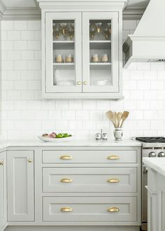 Looking for some grey and gold kitchen inspiration? Here's a sneak peek at our grey and gold kitchen renovation + the images that inspired me! Two Tone Kitchen Cabinets, Kitchen Cabinet Design, Kitchen Redo, Interior Design Kitchen, New Kitchen, White Cabinets, Kitchen Ideas, Kitchen Cabinetry, Kitchen Backsplash