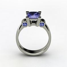 Love this setting, especially the two bezel set stones on either side of center.