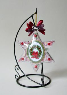 Christmas bauble with embroidered wreath.