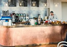 Artisan, London. Copper counter and blue La Marzocco.