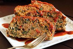 Quick and easy Paleo Meatloaf recipe that kicks the excitement up a notch. Can be made with ground turkey or beef. Includes spinach and other veggies inside!